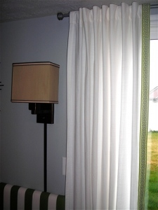 http://budgetwisehome.com/dressing-up-plain-curtains/
