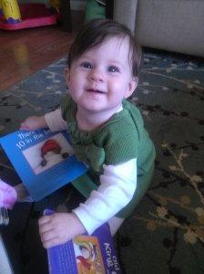 Emily loves reading her books :-)