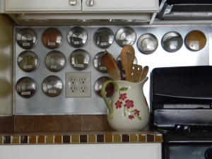 My spice containers--I designed the magnetic backsplash around using these (yay for heating duct supplies at Lowes)
